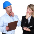 Stock Photo: Architect and builder thinking about same thing