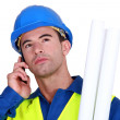 Stock Photo: Young blue collar on phone