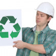 Curious worker holding recycle logo — Stock Photo #16839513