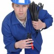 Electrician brandishing electrical clippers — Stock Photo