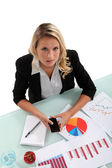 Woman examining charts — Stock Photo