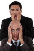 Shocked business duo — Stock Photo