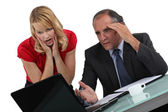 Businessman and woman facing a problem — Stock Photo