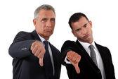 Businessmen, thumbs down — Stock Photo