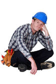 Bored manual worker sat cross-legged — Stock Photo