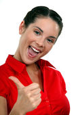 Peppy woman giving the thumb — Stock Photo