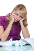 Overwhelmed secretary having a headache — Stock Photo