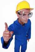 Manual worker with a finger up. — Stock Photo