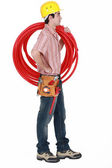 Plumber carrying spool of piping — Stock Photo