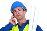 Young blue collar on the phone — Stock Photo