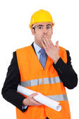 Construction businessman putting a hand on his mouth — Stock Photo