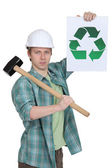 Construction worker with recycling poster — Stock Photo
