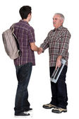 Experienced tradesman welcoming his new apprentice — Stock Photo