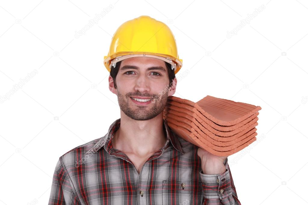 Craftsman holding roof tiles — Stock Photo #16838547