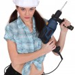 Sexy womwith drill — Stock Photo #16840435