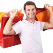 A man with plenty of shopping bags. — Stock Photo