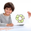 Child drawing recycling symbol — Stock Photo