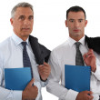 Two businessmen stood with folders — Stock Photo