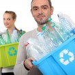 Man and woman recycling plastic bottles — Stock Photo #16844353