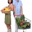 Royalty-Free Stock Photo: Market vs supermarket: Couple shopping for fruit and vegetables