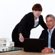 Architect and assistant working on housing project — Stock Photo #16845191