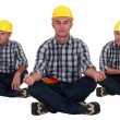 Stock Photo: Builder in yogsitting position