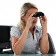 Woman with binoculars in the Office — Stock Photo #16846513