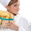 Girl with a crate of potatoes — Stock Photo
