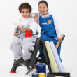 Children with paint cans — Stock Photo #16847823