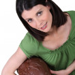 Woman holding an enormous chocolate Easter egg — Stock Photo