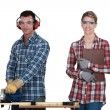 Craftsman and craftswoman together - Stock Photo
