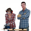 Foto Stock: Couple using circular saw