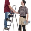 Two handymen shaking hands — Stock Photo