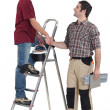 Stock Photo: Two handymen shaking hands