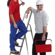 Royalty-Free Stock Photo: Two electrician collaborating on project