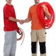 Stock Photo: Craftsmand apprentice shaking hands