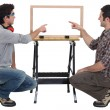 Father and son making wooden frame — Stock Photo