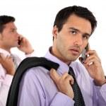 Two businessmen making telephone calls — Stock Photo
