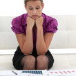 Stock Photo: Focused businesswomanalysing statistics