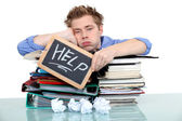 Student swamped under work — Stock Photo