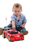 Boy playing with race car — Stock Photo