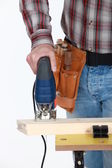 A cropped picture of a handyman using a jigsaw. — Stock Photo