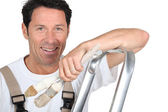 Painter with a stepladder — Stock Photo