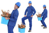 Construction worker carrying recyclable material — Stock Photo