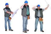 Chubby builder holding plans — Stock Photo