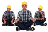 Builder in yoga sitting position — Stock Photo
