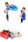 Male duo of plumbers with tools — Stock Photo
