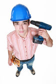 Man holding power drill against head — Stock Photo