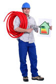 A plumber holding a diagram. — Foto Stock