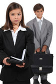 Little boy and girl dressed in business clothing — Stock Photo